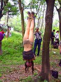 People shocked by suspending of girl upside down in the park