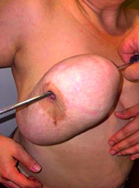 Extreme and brutal pricking of tits with sharp tools till crazy hurt