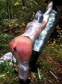 Extreme outdoor mummification then punishment and play with inflatable toys