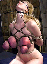 Girl is trying to withstand the pain of tightly bound boobs for several hours