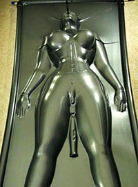 The girl in very extreme and dangerous vacuum bag stimulated with vibrator