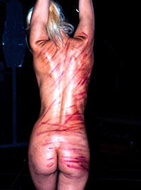 Public punishment of blonde masochist in the San Francisco BDSM Dungeon