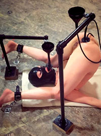 The Master pours various liquids including molten lead into all the holes of his slave