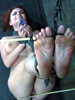 Redheaded girl shackled