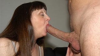 Fully erect penis in mature woman's mouth
