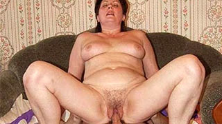Mature woman with legs wide open and penis inside her