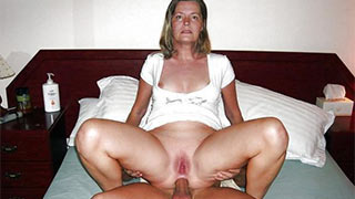 Mature woman feeling cock entering her asshole
