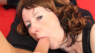 The head of her young lover's cock just entered mature mouth