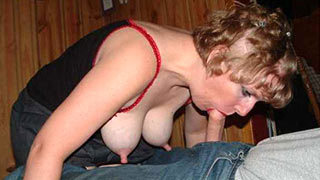 Mature woman taking the prick into her mouth