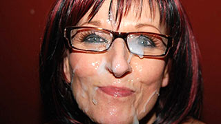 Mature woman's cum covered face