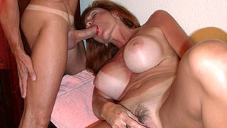 Mature woman with big tits sucking cock