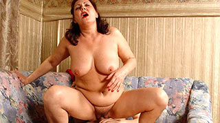Mature woman fucking on the couch