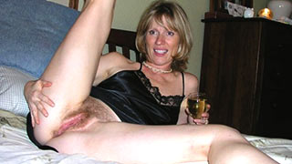 Mature woman spreading her legs
