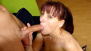Mature woman having the young guy's hot cock in her mouth