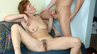 Naked mature woman spreading and jerking cock