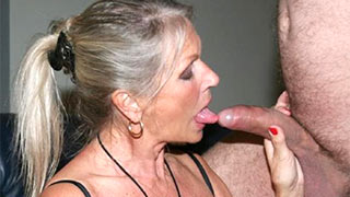 Mature woman laved the swollen head of the cock with her tongue