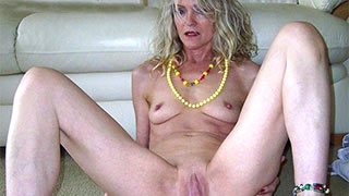 Naked mature woman spreading her legs