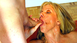 Young cock in mature woman's mouth