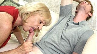Mature woman gave the guy's cock a tentative squeeze