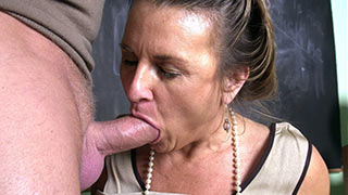 The cock slowly sliding in and out of mature partner's mouth