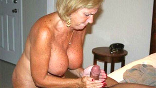 Mature woman stroked the cock until it stood up stiffly