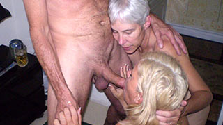 Two mature women sucking cock