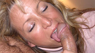 Mature woman holding the base of her lover's hard prick