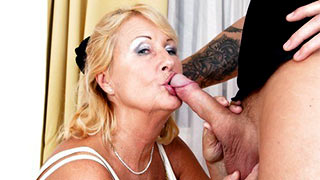 Mature woman kissing cock