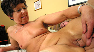 Mature woman grabbing the balls harder against her cunt