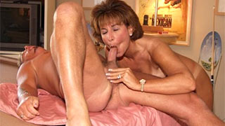 Mature woman fucking her mouth on the young guy's hard prick