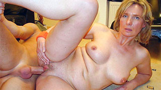 The guy trying to fuck his cock deeper into mature woman's cunt