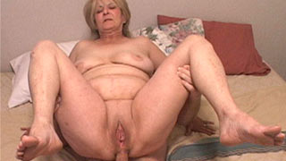 Mature woman has a huge cock up her ass