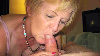 Mature woman curled her fingers about the cock and started jerking
