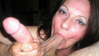 Mature woman took young guy's balls Into her mouth