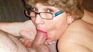 Young guy's big cock fucking mature woman's throat