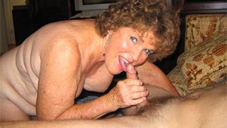 Mature woman began to suck her young lover's cock hungrily