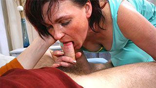 Mature woman opened her mouth and took the cock between her lips