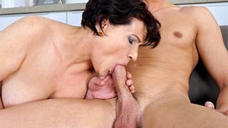 Mature woman taken her young lover's growing cock into her mouth