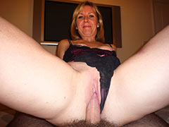 Happy wife spreads for home cam